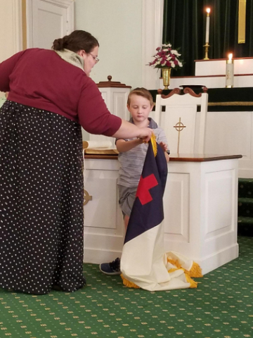 images/stories/HeaderImages/Frame1/Calan with Christian flag2.jpg